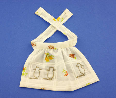 vintage doll: An interesting view of a vintage doll apron.