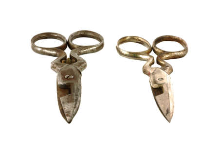 buttonhole: This is a front view of two pairs of vintage buttonhole scissors. Stock Photo