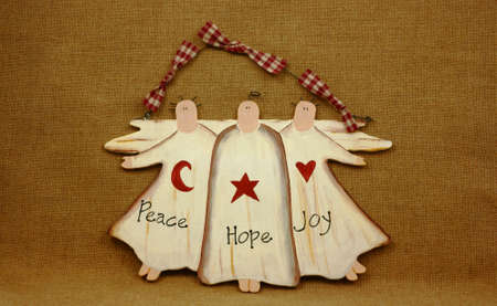 An interesting view of a rustic Peace, Hope, Joy christmas wall hanging. Stock Photo - 5268587