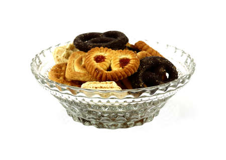 A nice assortment of cookies in a glass bowl. photo