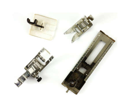 attachments: Good overhead view of four useful presser foot attachments.
