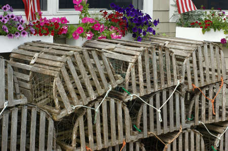 A nice view of lobster traps stacked beneath window boxes. photo