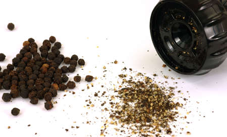 peppercorns: A view of whole, ground peppercorns and grinder.