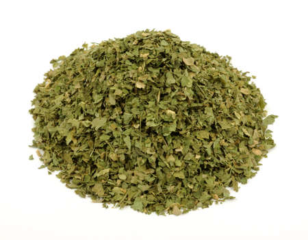 source of iron: A nice view of parsley flakes on white. Stock Photo
