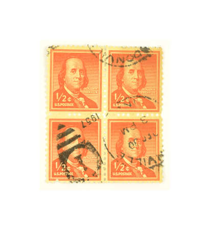 A nice view of a block of Benjamin Franklin half cent stamps. photo