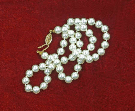 A nice view of a strand of just plain pearls. photo