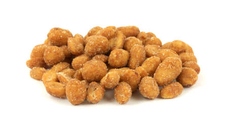 satisfying: A tempting front view of a group of roasted peanuts. Stock Photo