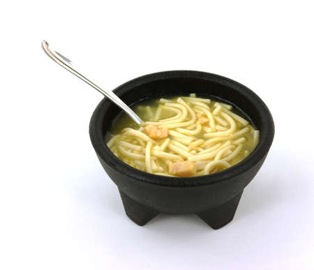 chicken noodle soup: A nice view of chicken noodle soup in a black bowl.