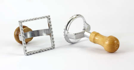 sturdy: A pair of sturdy pastry cutters facing each other.