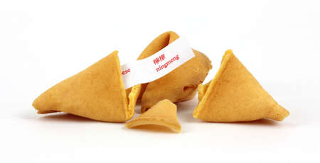 Beautiful golden brown fortune cookies and pieces. photo