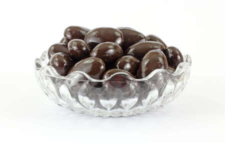 tempting: Tempting view of chocolate covered almonds in bowl.