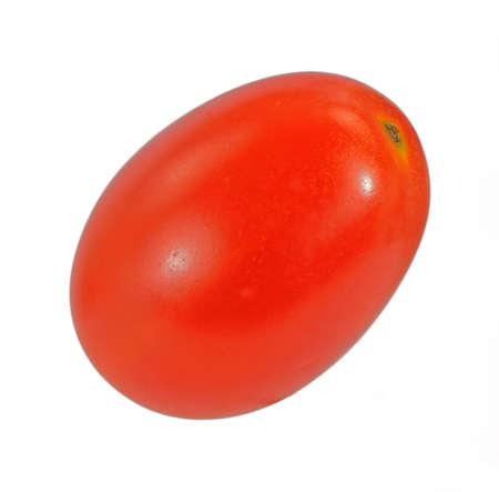 A very colorful firm single grape sized tomato. photo