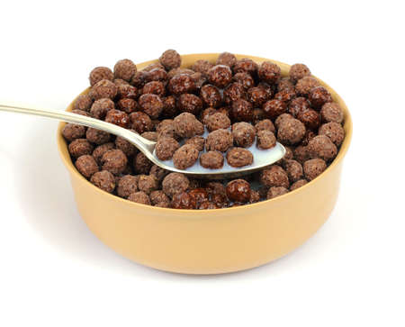 A serving of crispy chocolate flavored cereal with milk. photo