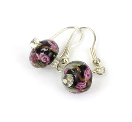 A beautiful vintage pair of colorful pierced earrings. photo
