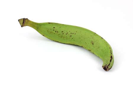 A single large plantain banana at an angle. photo