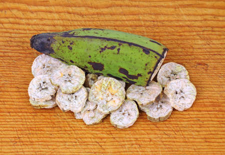 splotchy: Interesting colorful slices and half plantain banana.