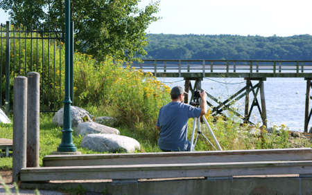 A photographer composing a late afternoon shot. photo