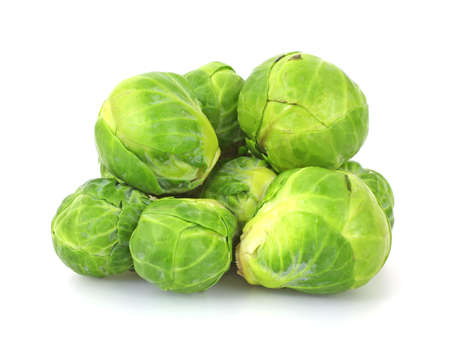 tightly: A small group of stacked fresh Brussels sprouts.   Stock Photo