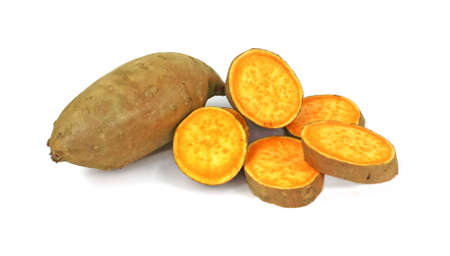 A large sweet potato and several colorful slices. photo