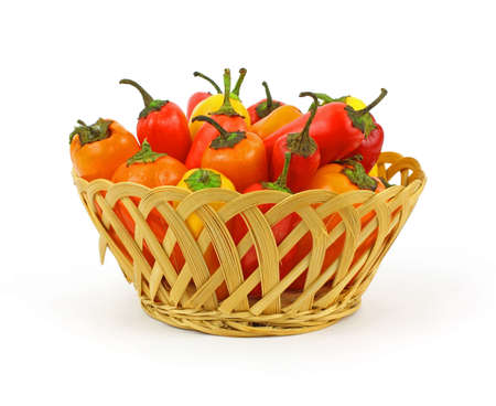 A basket full of bright and colorful sweet mini peppers.  photo