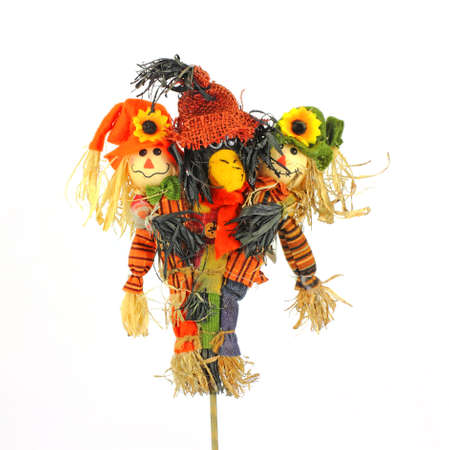 A colorful group of scarecrows bonded together.  photo