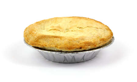 A front view of an individual apple pie.  photo