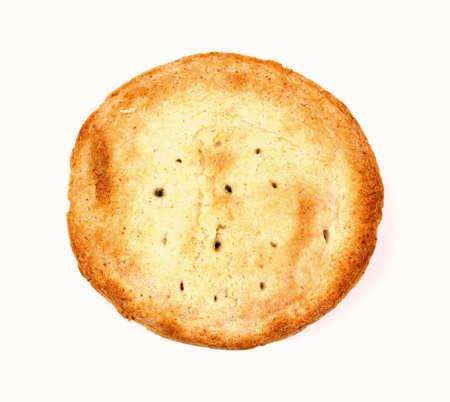 A golden brown individual apple pie crust.  photo