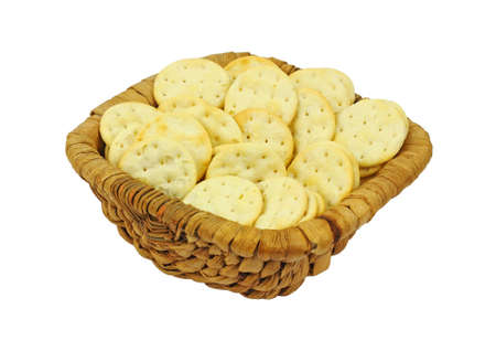 browned: Lightly browned crispy  round snack crackers in basket.