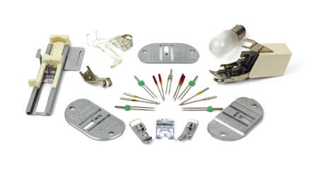 attachments: A variety of sewing machine supplies and attachments.