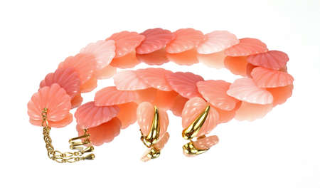 predominant: A beautiful mirror image of a pink shell necklace. Stock Photo