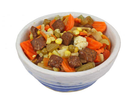 An overhead view of canned vegetable beef soup. photo
