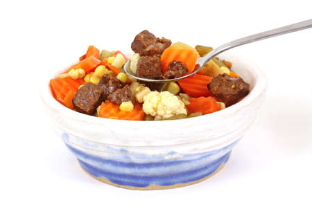 tempting: A tempting view of a spoon of vegetable beef soup. Stock Photo