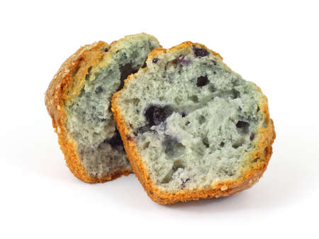 A delicious split freshly baked blueberry muffin.  photo