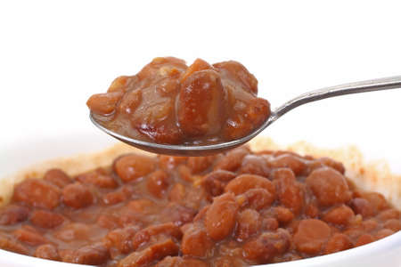 heaping: A heaping spoonful of canned pinto beans.