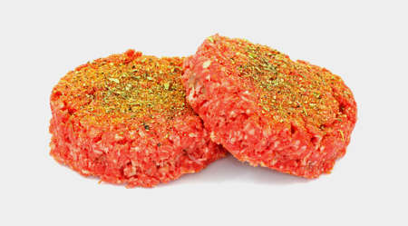 Thick lean ground beef patties ready for cooking. photo
