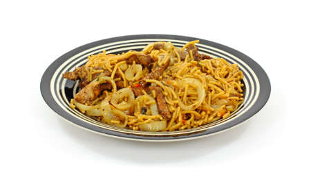 tempting: A tempting view of sauteed pork strips and noodles.