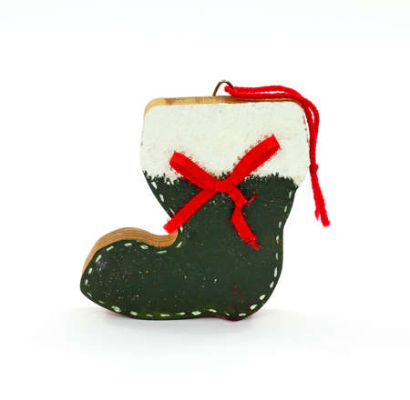 An old homemade Santa boot Christmas tree ornament. Stock Photo - 9574195