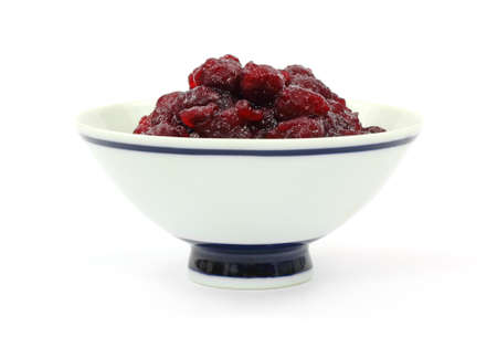 A front view of canned cranberry sauce with whole berries. photo
