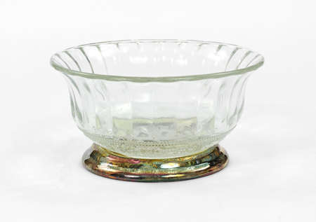 tarnished: A vintage crystal bowl on a tarnished silverplate base. Stock Photo