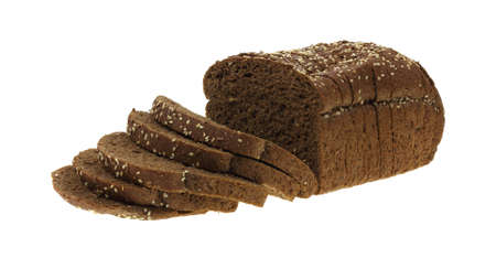 Slices of a dark whole grain wheat bread loaf. photo