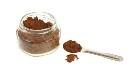 heaping: A heaping spoon of allspice and small jar.