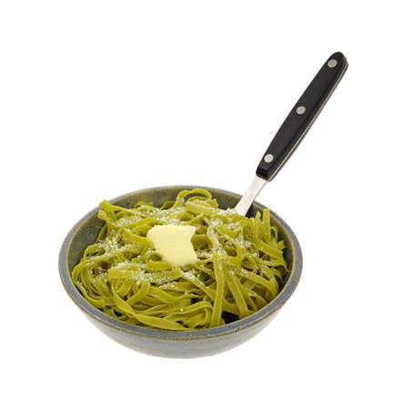 buttered: Buttered spinach pasta sprinkled parmesan cheese. Stock Photo