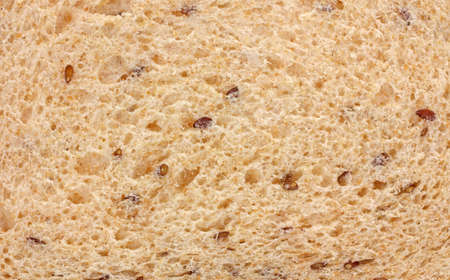 flaxseed: A close view of a slice of flaxseed bread.