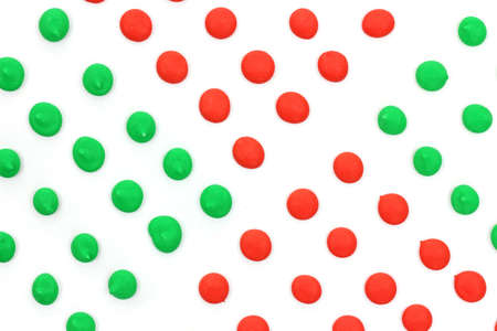 satisfying: Red cherry and green apple dots in diamond shapes. Stock Photo