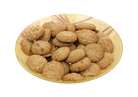 A full plate of small oatmeal cookies  photo