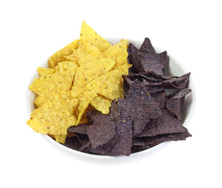 corn tortilla: The yellow corn tortilla chips combined with blue. Stock Photo