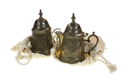 discolorations: Silver plated sugar and creamer with protective sacks