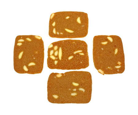 A group of four tops of almond wafer cookies with the bottom in the center  photo