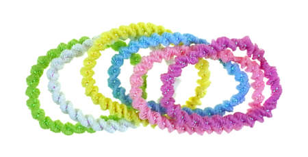 pony tail: A row of the six colors of the elasticized crinkled chenille pony tail holders  Stock Photo