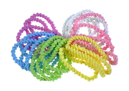 pony tail: A group of colorful elasticized pony tail holders